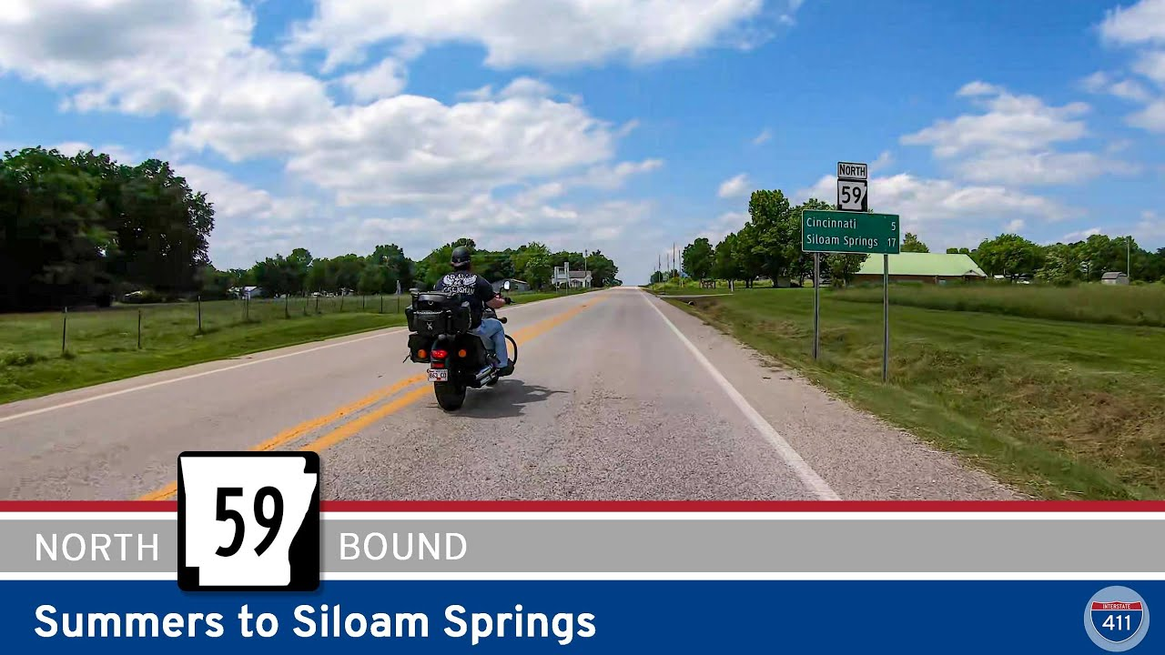 Drive America's Highways for 15 miles north along Arkansas Highway 59 from Summers to Siloam Springs.